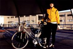 amy_and_bike_at_ferry_terminal.jpg
